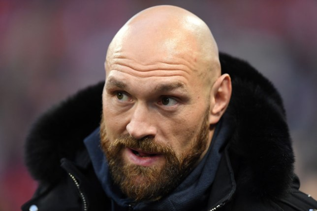 Heavyweight boxer Tyson Fury answers questions and poses for pictures at an NFL game in London