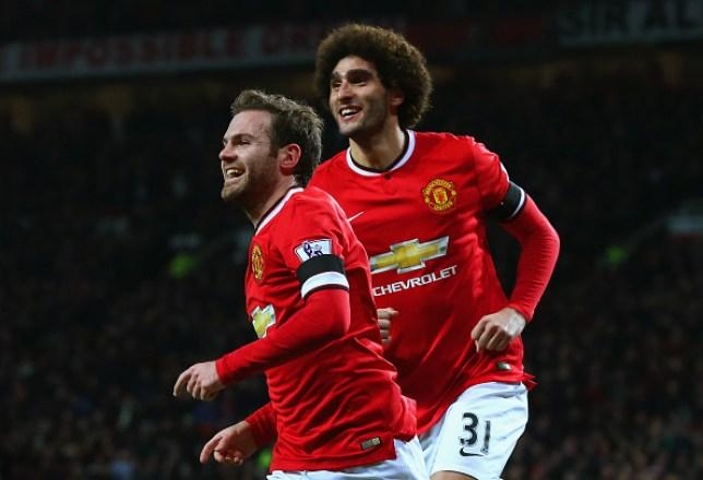 Juan Mata and Marouane Fellaini celebrating a Manchester United goal