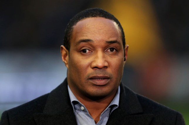 Former Manchester United midfielder Paul Ince looks on while working as a pundit