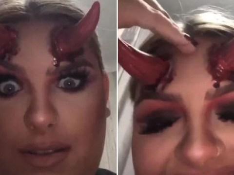 Woman's PrettyLittleThing Halloween devil horns get stuck on her head
