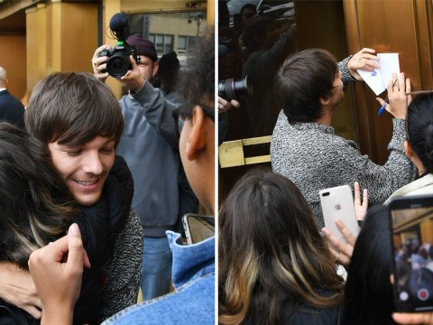 Louis Tomlinson signs autographs for fans in New York after announcing first solo album