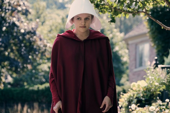 "Television programme : The Handmaid's Tale -- ""Offred"" Episode 101 -- Offred, one the few fertile women known as Handmaids in the oppressive Republic of Gilead, struggles to survive as a reproductive surrogate for a powerful Commander and his resentful wife. Offred (Elisabeth Moss), shown. (Photo by: George Kraychyk/Hulu)"