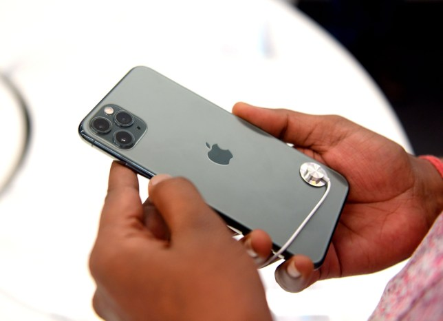 SIPA USA via PA Images An Apple mobile lover seen checking the specification of newly launched Apple phone at a shopping mall in Kolkata. Apple iPhone 11 smartphone officially launched in India. (Photo by Avishek Das / SOPA Images/Sipa USA)