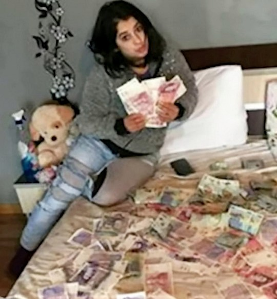 Spiru on a bed flaunting cash. A burglary gang thought to have made a fortune after being linked to hundreds of break-ins at wealthy homes are facing jail at Birmingham Crown Court today, October 1, 2019. The four men, all from Romania, were part of a sophisticated gang that took advantage of dark winter nights between November 2018 and January 2019, to target affluent properties, for jewellery and other valuables, before flying back to Romania in the New Year. Catalin Zaharia and Constantin Stoian, both 29, Marian Molocia, 27, and Daniel Stoean, 35, admitted conspiracy to burgle. A fifth person, Florina Spiru, 27, was found guilty of money laundering after a trial but cleared of the burglary charge.