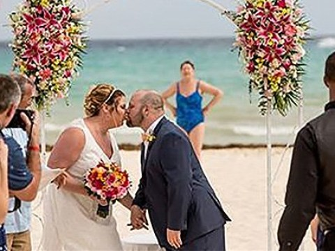 Swimmer photombombs couple's first picture as man and wife during private wedding ceremony