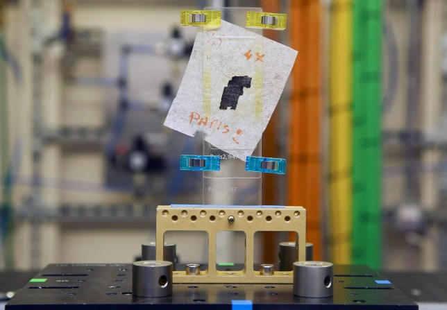A piece of Herculaneum scroll is pictured in the experimental hutch area after recently being scanned, at Diamond Light Source in Didcot, west of London on September 30, 2019. - Researchers have been using the UK's national synchrotron science facility, Diamond Light Source, to examine fragments of 2,000 year-old of Herculaneum scroll, owned by the Institut de France, in the hope of using the high energy X-ray beamline to decode the fragments of scrolls. (Photo by GEOFF CADDICK / AFP) (Photo by GEOFF CADDICK/AFP via Getty Images)
