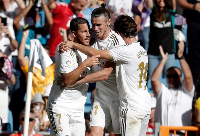 MADRID, SPAIN - OCTOBER 05: Eden Hazard (L) of Real Madrid celebrates with Gareth Bale and Alvaro Odriozola (R) after scoring a goal during the La Liga match between Real Madrid CF vs Granada FC at the Santiago Bernabeu stadium in Madrid on October 05, 2019. (Photo by Burak Akbulut/Anadolu Agency via Getty Images)
