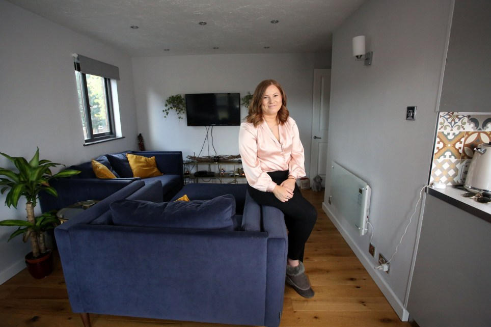 Homeowner Lauren Crockford pictured in the living room of her one bedroomed flat in Sydenham, London, October 6th, 2019. Lauren pays roughly ?780 a month in mortgage not including bills. Photo Credit: Susannah Ireland