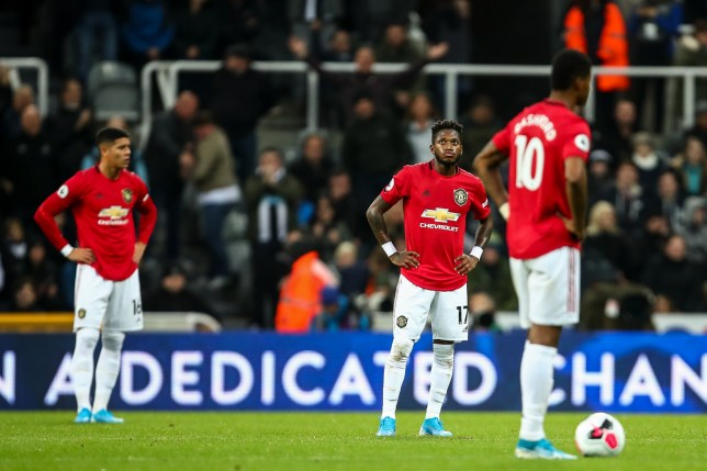 Manchester United's players look dejected after Matty Longstaff's goal for Newcastle United