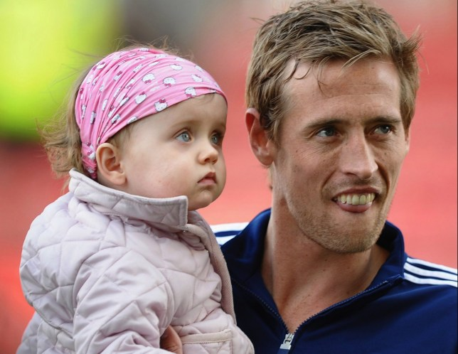 STOKE ON TRENT, ENGLAND - MAY 13: Peter Crouch of Stoke City and daughter Sophia look on after the Barclays Premier League match between Stoke City and Bolton Wanderers at Britannia Stadium on May 13, 2012 in Stoke on Trent, England. (Photo by Laurence Griffiths/Getty Images)
