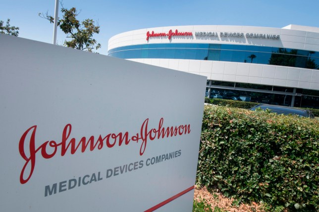 An entry sign to the Johnson & Johnson campus shows their logo in Irvine, California on August 28, 2019. - The US pharmaceutical industry faces tens of billions of dollars in potential damage payments for fueling the opioid addiction crisis after Oklahoma won a $572 million judgment against drugmaker Johnson & Johnson. (Photo by Mark RALSTON / AFP) (Photo credit should read MARK RALSTON/AFP/Getty Images)