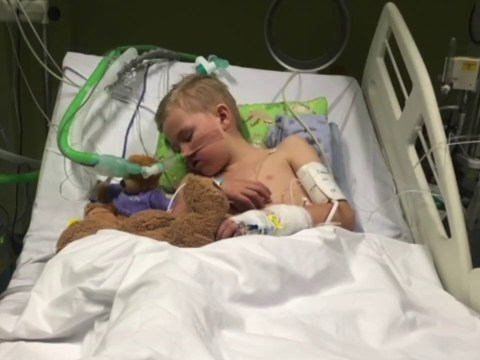 Mum shares picture of son, 8, lying in intensive care with the flu