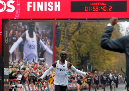 Eliud Kipchoge finished in a time of on hour 59 minutes and 40 seconds