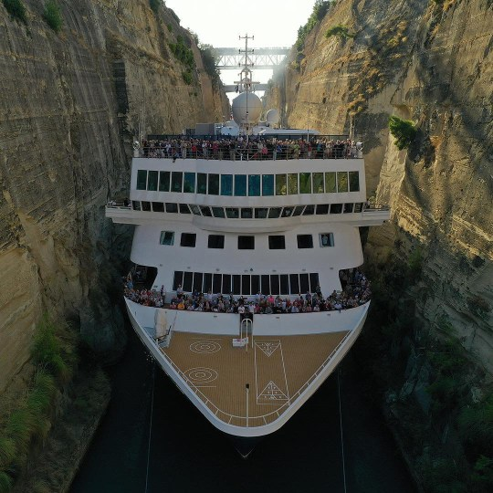 Cruise liner squeezes through tiny Greek canal