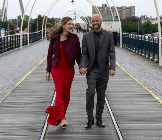Christopher Rimmer and Viktorija Vakulenko walking across a bridge