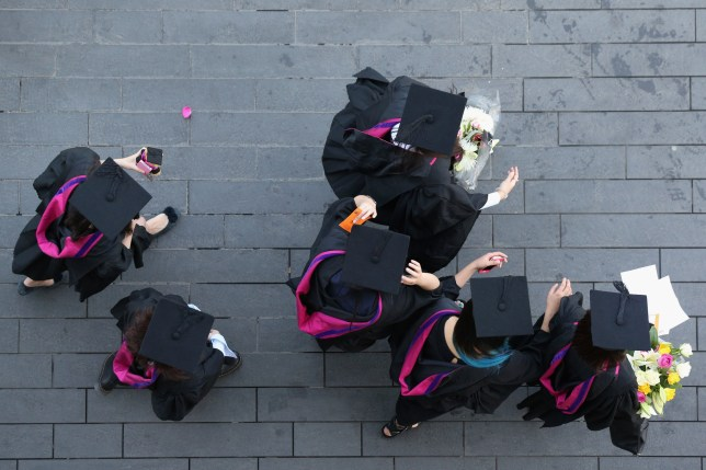 LONDON, UNITED KINGDOM - JULY 18: Students wear gowns and mortarboards as they prepare to attend their graduation ceremony in the Royal festival Hall on the Southbank on July 18, 2013 in London, England. The United Kingdom is experiencing a second week of heatwave conditions. (Photo by Oli Scarff/Getty Images)