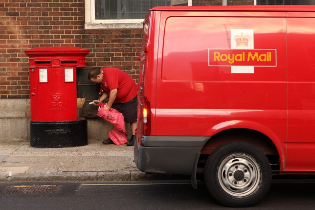 LONDON, ENGLAND - OCTOBER 16: A Royal Mail employee empties a post box in Southwark on October 16, 2009 in London, England. The Communication Workers' Union has announced two 24-hour nationwide strikes beginning on October 22, 2009 over pay, working conditions and reform. (Photo by Oli Scarff/Getty Images)