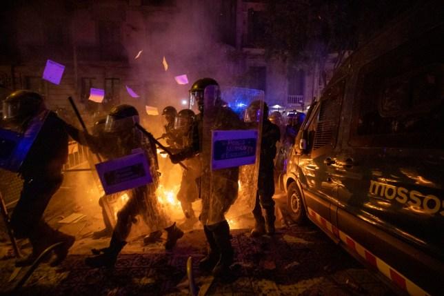 Policemen in riot gear clash with protestors in Barcelona