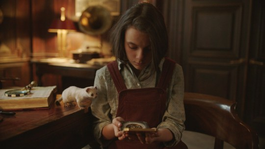 WARNING: Embargoed for publication until 00:00:01 on 18/07/2019 - Programme Name: His Dark Materials - TX: 18/07/2019 - Episode: n/a (No. n/a) - Picture Shows: Lyra (Dafne Keene) with her daemon Pantalaimon, seen here as an ermine. Lyra Belacqua (DAFNE KEEN) - (C) ?? Bad Wolf - Photographer: screen grab