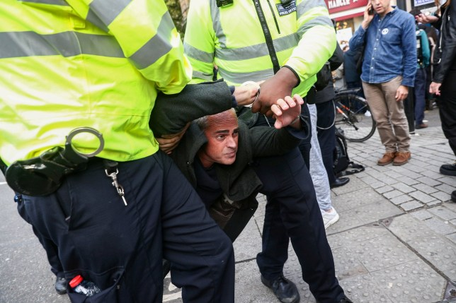 Green Party leader Jonathan Bartley is arrested as police move in on the Extinction Rebellion protest, including Guardian columnist George Monbiot, in Whitehall London. 16 October 2019