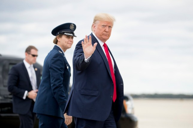 Photo of Donald Trump walking to board Air Force One
