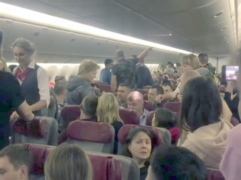Passengers wrap drunk man in cling film after he tried to kick open plane door