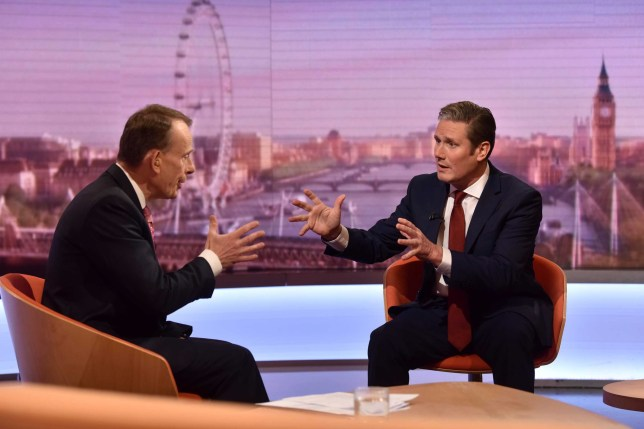 "In a handout picture released by the BBC Britain's main opposition Labour Party shadow Secretary of State for Exiting the EU Keir Starmer (R) gestures as he talks to British journalist Andrew Marr (L) on the BBC political programme The Andrew Marr Show in London on October 20, 2019. - Britain will leave the European Union on time on October 31, the government insisted Sunday after MPs voted to force the Prime Minister into seeking yet another delay. Johnson reluctantly sent European Council President a letter legally imposed on him by parliament requesting an extension -- but refused to sign it. (Photo by JEFF OVERS / BBC / AFP) / RESTRICTED TO EDITORIAL USE - MANDATORY CREDIT "" AFP PHOTO / JEFF OVERS-BBC "" - NO MARKETING NO ADVERTISING CAMPAIGNS - DISTRIBUTED AS A SERVICE TO CLIENTS TO REPORT ON THE BBC PROGRAMME OR EVENT SPECIFIED IN THE CAPTION - NO ARCHIVE - NO USE AFTER **NOVEMBER 9, 2019** / (Photo by JEFF OVERS/BBC/AFP via Getty Images)"