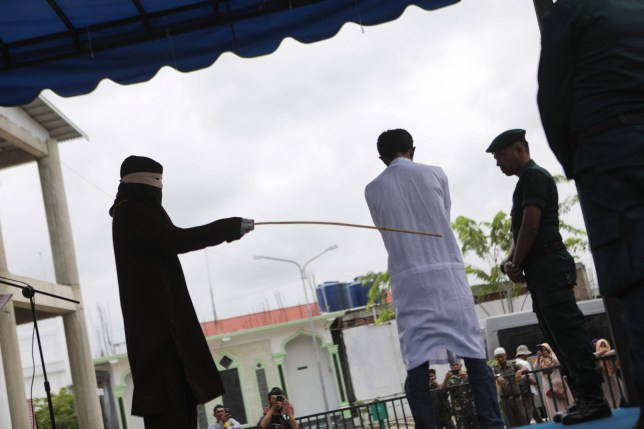 epa07938006 A man accused of gambling receives a public caning punishment in Banda Aceh, Indonesia, 21 October 2019. Aceh is the only province in Indonesia that implements Sharia law and considers lesbian, gay, bisexual relationships and sex outside of marriage as Sharia law violations. EPA/HOTLI SIMANJUNTAK