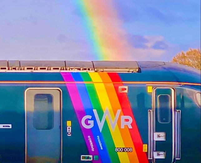This is the fabulous moment a rainbow appears to perfectly align with one of GWR?s Pride trains as it departed from Bristol Temple Meads. See SWNS story SWSYrainbow. A commuter managed to snap this amazing photo of a sunset rainbow - perfectly in line with a GWR Pride train. Financial controller Neil Criddle, 35, was catching a train home to Weston-super-Mare from Bristol when the rainbow appeared in the sky. Noticing it was in line with a GWR Pride train on the opposite platform, quick-thinking Neil hopped on the train, whipped out his phone, and took a photo. He managed to snap this incredible shot as his train departed from Temple Meads - and as the GWR Pride train also moved away.