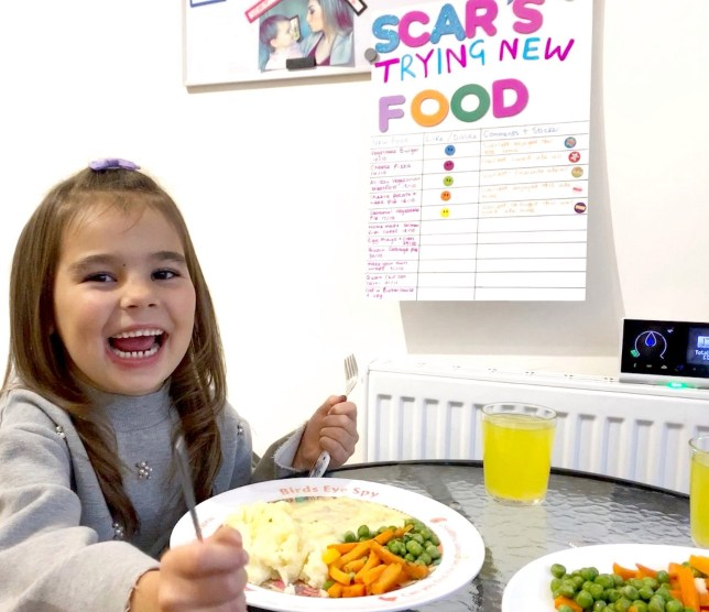 Scarlett-Mai, 5, with trying new food chart (Picture: @youngmumsdiaries/Caters)