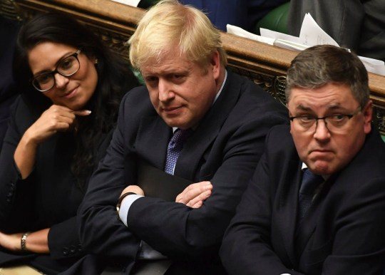 Britain's Prime Minister Boris Johnson, center, sits on the government front bench in the House of Commons in London following the debate for the EU Withdrawal Agreement Bill, Tuesday Oct. 22, 2019. British lawmakers have rejected the government???s fast-track attempt to pass its Brexit bill within days, demanding more time to scrutinize the complex legislation and throwing Prime Minister Boris Johnson???s exit timetable into chaos. (Jessica Taylor, UK Parliament via AP)