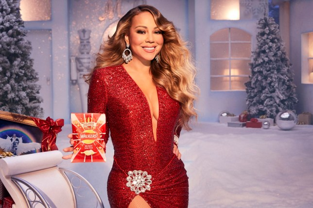 Walkers undated handout photo of Mariah Carey as she stars in this year's Christmas advert for the crisp brand which is set to launch in November. PA Photo. Issue date: Wednesday October 23, 2019. The campaign ties in with Carey?s 1994 festive album, Merry Christmas, celebrating its 25th anniversary this year. See PA story SHOWBIZ Carey. Photo credit should read: Walkers/PA Wire NOTE TO EDITORS: This handout photo may only be used in for editorial reporting purposes for the contemporaneous illustration of events, things or the people in the image or facts mentioned in the caption. Reuse of the picture may require further permission from the copyright holder.