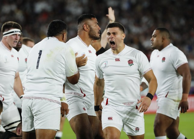 England's Manu Tuilagi celebrates with teammates after scoring a try in the rugby world cup semi-final