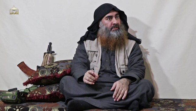 """(FILES) In this undated filer image grab taken from a video released by Al-Furqan media on April 29, 2019, the chief of the Islamic State group Abu Bakr al-Baghdadi purportedly appears for the first time in five years in a propaganda video in an undisclosed location. - Baghdadi was believed to be dead after a US military raid in Syria's Idlib region, US media reported early Sunday. Baghdadi may have killed himself with a suicide vest as US special operations forces attacked, media said citing multiple government sources. (Photo by - / AL-FURQAN MEDIA / AFP) / THIS PICTURE WAS MADE AVAILABLE BY A THIRD PARTY. AFP CAN NOT INDEPENDENTLY VERIFY THE AUTHENTICITY, LOCATION, DATE AND CONTENT OF THIS IMAGE. THIS PHOTO IS DISTRIBUTED EXACTLY AS RECEIVED BY AFP. RESTRICTED TO EDITORIAL USE - MANDATORY CREDIT """"AFP PHOTO / SOURCE / AL-FURQAN"""" - NO MARKETING - NO ADVERTISING CAMPAIGNS - DISTRIBUTED AS A SERVICE TO CLIENTS / (Photo by -/AL-FURQAN MEDIA/AFP via Getty Images)"""
