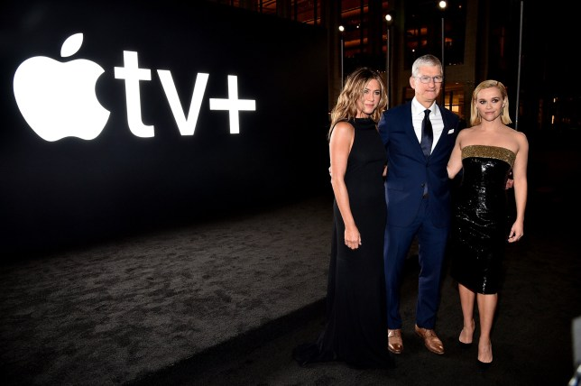 Jennifer Aniston, Apple CEO Tim Cook and Reese Witherspoon attend an Apple TV Plus competition