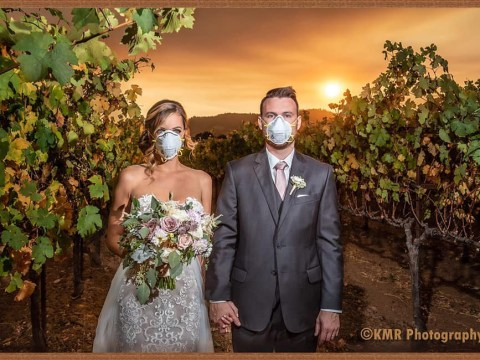 Couple pose for their wedding photos in front of California wildfire
