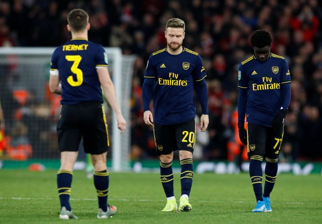 Shkodran Mustafi and Bukayo Saka hang their heads after Liverpool pulled back a late goal