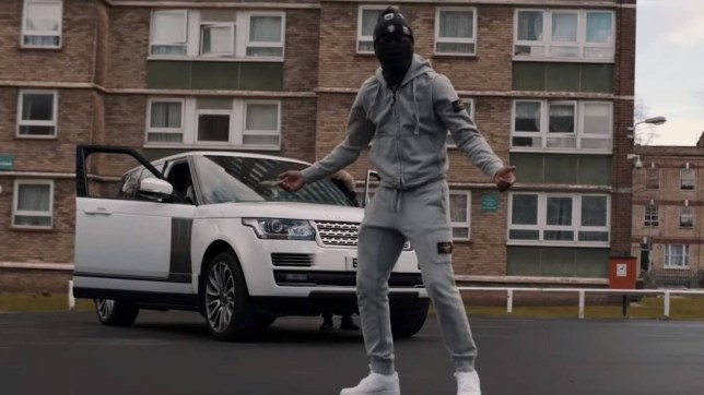 Rico Racks in his music video for Sinning and Winning