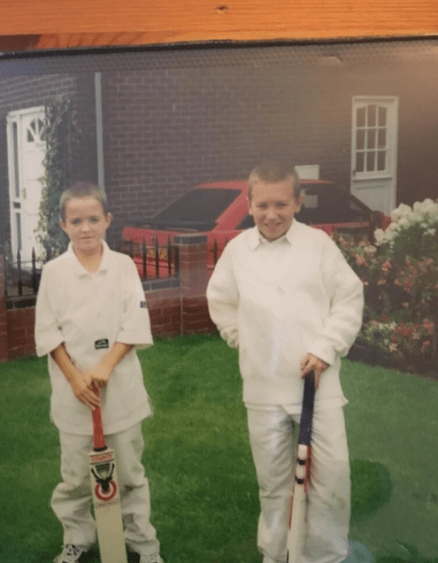 Tommy as a young boy in cricket whites