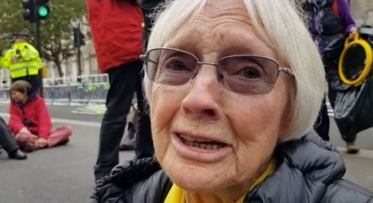 Extinction Rebellion protester, 83, glues herself to road in Westminster October 7, 2019