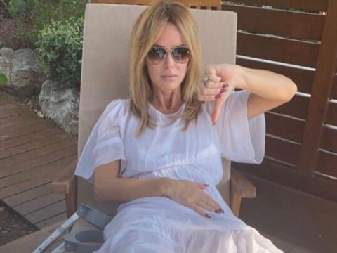 Broken leg won't stop Amanda Holden from partying as she attends Lisa Faulkner and John Torode's wedding