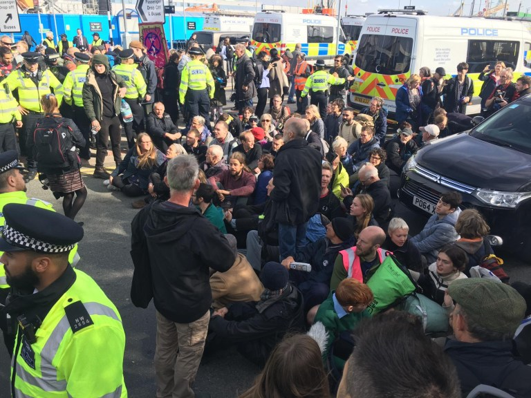 XR protesters glue themselves to tarmac outside the airport