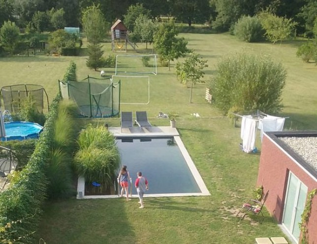 enjoying the ecopool at a homeswap in Belgium