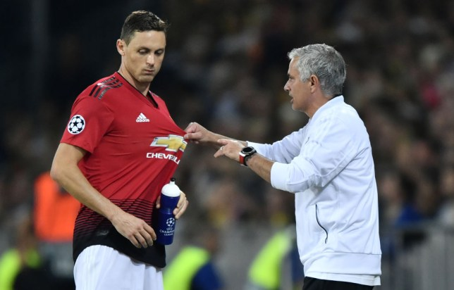 Jose Mourinho pulls on the shirt of Nemanja Matic as he gives him instructions