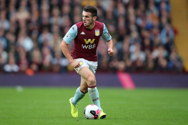 Manchester United transfer target John McGinn carries the ball while playing for Aston Villa