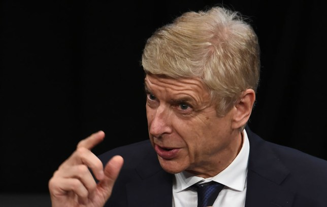 Football manager Arsene Wenger tries to make his point as he speaks to media in Japan