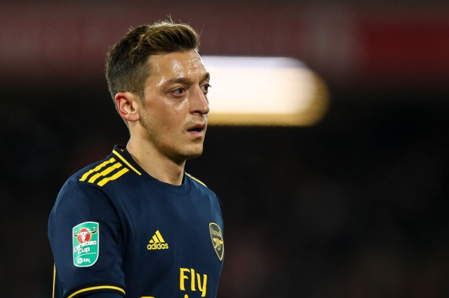 Mesut Ozil looks on during Arsenal's Carabao Cup defeat to Liverpool