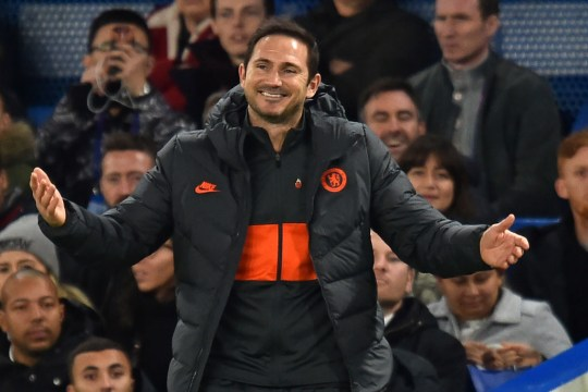 Frank Lampard smiles and holds out his arms on the touchline as Chelsea take on Ajax