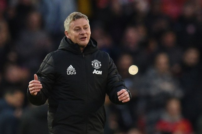 Ole Gunnar Solskjaer smiles during Manchester United's game against Brighton