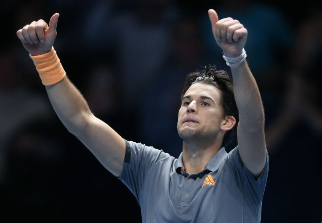 Dominic Thiem gives a thumbs up to the crowd after a dramatic win over Novak Djokovic at the ATP Finals